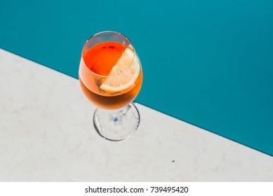 Spritz Aperol drink by a pool. Traditioanal italian aperitif.