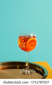 Spritz Aperol veneziano, an IBA cocktail with Prosecco or white sparkling wine, bitter, soda, ice and a slice of orange, in a calix on a table, pop graphic style