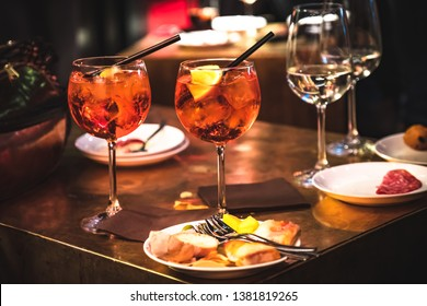Spritz cocktail and appetizer on the table. Italian aperitivi and cocktail drinks.