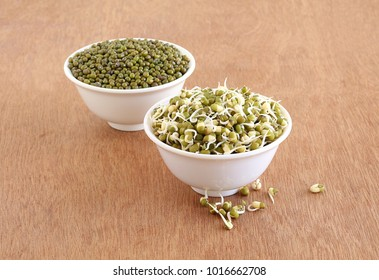 Sprouted moong, mung or green gram, organic type, a healthy vegetarian food in bowl, and in the background is a bowl of regular moong.