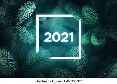 Spruce branches in the background and glowing frame from the year 2021 - Shutterstock ID 1784340782