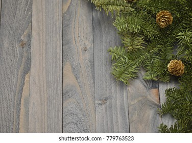 Spruce branches on wooden background. Winter still life. Photo background.