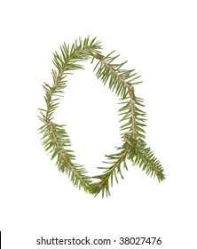 Spruce twigs forming the letter 'Q' isolated on white