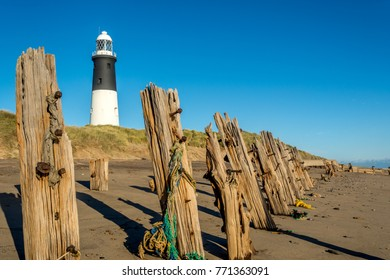 Spurn Point lighthouse and old wooden beach sea defences