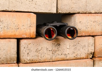 Spy glass sticking out of a wall, an immigration concept