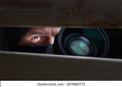Spy Man. Peeping. Spying. Surveillance. Secret Information. Hidden Camera. Man hiding. Paparazzi. Stalker. Private Detective. Spy Camera. Spy Detective. Espionage. Privacy. Information. Investigation
