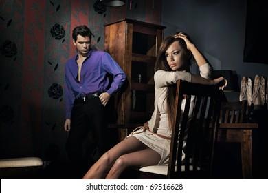 Squabbled couple in stylish apartment