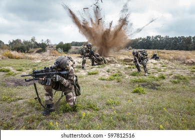 Squad of elite french paratroopers of 1st Marine Infantry Parachute Regiment RPIMA ambushed in action, landmine exploding