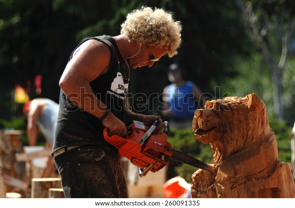 SQUAMISH, BC, CANADA - AUGUST 2, 2013: Loggers demonstrate their chainsaw skills during Squamish Days Loggers Festival in Squamish, BC, Canada, on August 2, 2013.