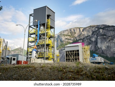 Squamish BC, Canada - August 21, 2021:  The Carbon Engineering Direct Air Capture (DAC) carbon capture plant with the Squamish Chief mountain in the background.