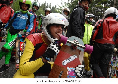SQUAMISH, BC, CANADA - MAY 25, 2014: Racers compete at the 2014 Britannia Classic Longboard Race in Squamish, BC, Canada, on May 25, 2014.