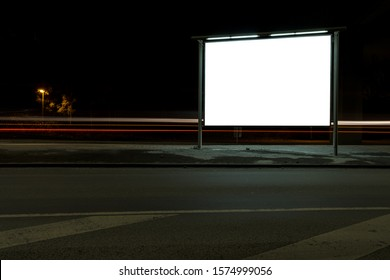 Square billboard mockup at night with car light trails