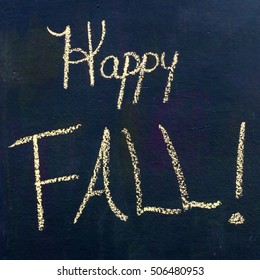 """Square Black Chalkboard Scene With The Seasonal Words """"Happy Fall"""" Drawn In Bright Yellow Chalk"""