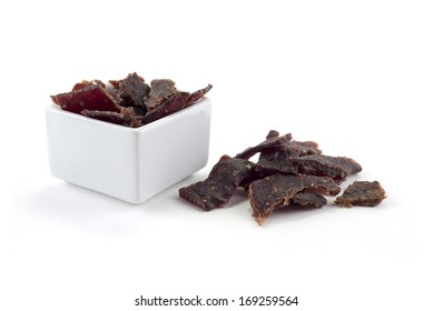 Square bowl with jerky isolated on white background