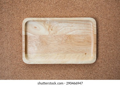 square bowl on the brown cork table