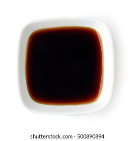 Square bowl of soy sauce isolated on white background, top view