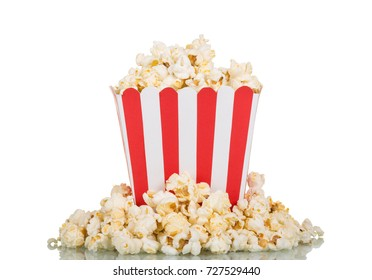 Square box filled with popcorn, part scattered, isolated on white background