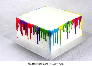 Square cake with rainbow color dripping