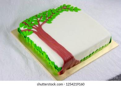 Square cake with tree fondant decoration.Family reunion  cake