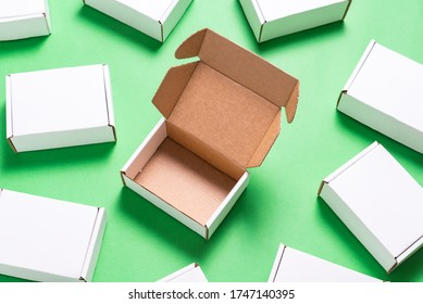 Lot of square carton boxes on green background