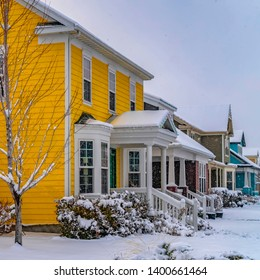 Square Charming homes on a snow covered landscape during winter in Daybreak Utah