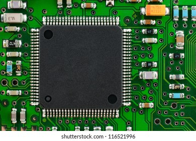 Square chip on the circuit board is green