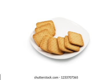 Square cookies on a white plate. Isolated on white background.