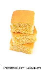 Square Cornbread Slices on a White Background