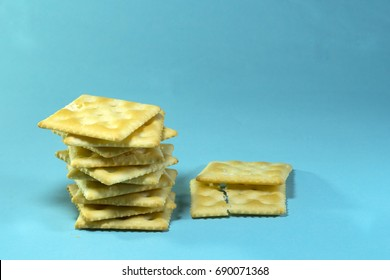 square crackers isolated on white background. Dry cracker cookies blue background
