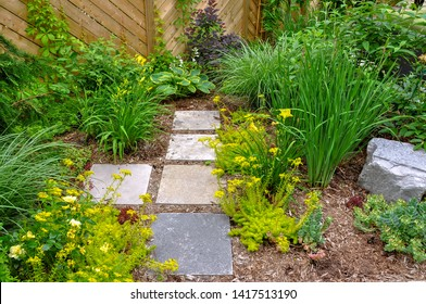 A square cut flagstone path provides access and a contemporary zen feel to this beautiful, Asian inspired small urban garden.
