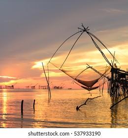 square dip net catch fish during sunrise at Pakpra Thailand