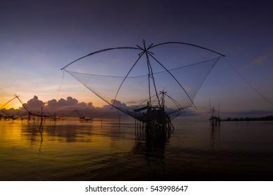 Square dip net catch fish at sunrise,Pakpra,Phatthalung, Thailand