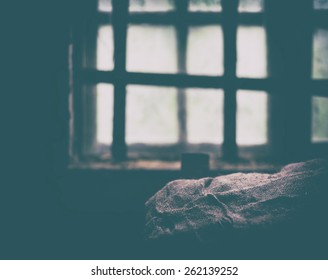 Square faded prison window bunk composition background