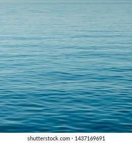 square format background of calm blue water with small waves and endless ripples and copy space - Shutterstock ID 1437169691