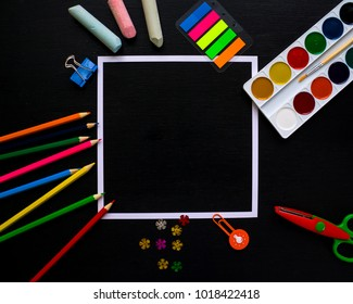 square frame with colorful pencils scissors on chalkboard background, space for text, flat lay, back to school concept