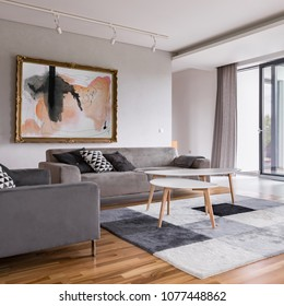 Square frame of modern living room with sofa, pattern carpet and balcony