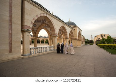 "Square in front of the Mosque ""Heart of Chechnya"". Muslim girls walking near mosque"