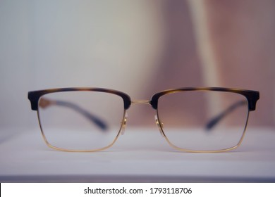 Square glasses with brown frames close up on a store shelf