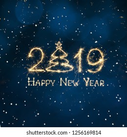 Square Greeting card Happy New Year 2019. Beautiful creative holiday web banner or billboard with Golden sparkling text Happy New Year 2019 written sparklers on festive blue background.