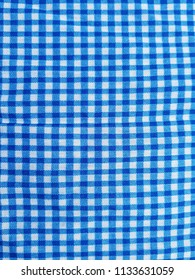 Square linen fabric or textile in cotton striped. Blue and white stripes. Background texture structure. Tilt up.