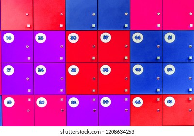 square of lockers in kindergarden, school, dressing room in pool, children room with numbers in white circles. Close Up Of Student Lockers In High School