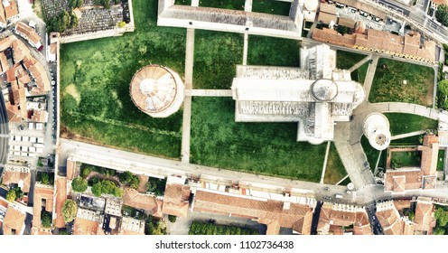 Square of Miracles in Pisa with surrounding city skyline. Aerial panoramic downward view on a summer morning.