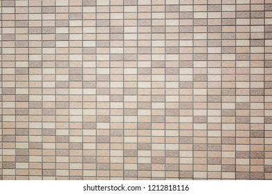 square mosaic background of tiles texture in brown color