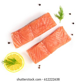 A square overhead photo of two slices of salmon on a white background with a place for text, with slices of lemon, salt and pepper, and dill sprigs