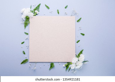 Square parchment paper mockup with florals framing the edges