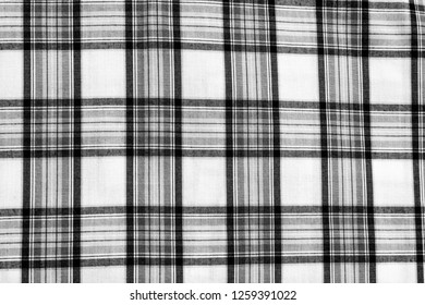 Square pattern black white fabric background. Scott chintz fabric for design. Plaid gray cotton knit texture. top view.