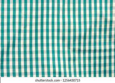 Square pattern green white fabric background. Scott chintz fabric for design. Plaid blue cotton knit texture. top view.