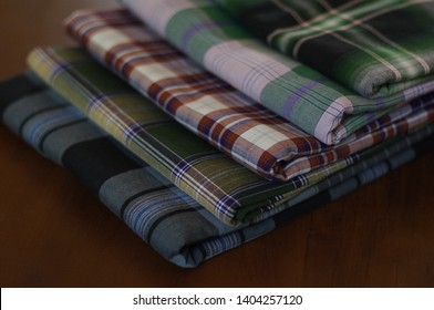 Square pattern of Indonesian sarung for men doing prayer