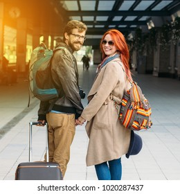 Square photo. Real view of amorous hipster couple walking down station and chatting outdoors. Holyday and weekend concept