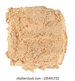 square pile of Ginger powder over white